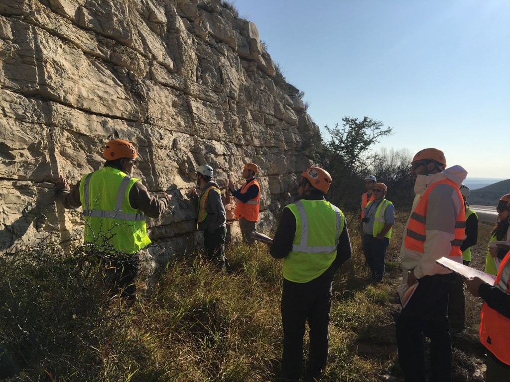 A group of geologists in the field who are mostly white men
