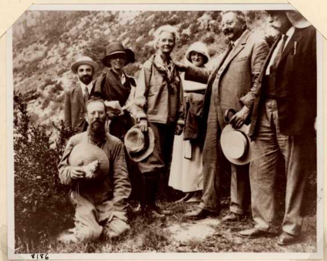 Annie Alexander with a gropu of men and women in the field